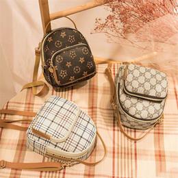 Ingrosso Zaino con stampa a stelle moda Retro Designer Personalità Plaid Pattern Borsa da donna Zaino casual Mini Bag Tote Bag Tracolle