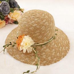 $enCountryForm.capitalKeyWord Canada - Designer Elegant Straw Sun Hats With Flower Women Summer Foldable Cap Wide Brim Visors Lady Church Bucket