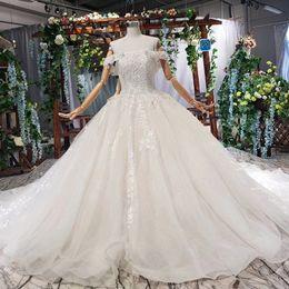 $enCountryForm.capitalKeyWord Australia - 2019 Latest Bohemian Wedding Dresses Off the Shoulder Short Sleeve Backless Lace Up Back Crystal Lace Applique Pattern Bridal Gowns Garden