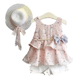 Wholesale pompom clothing resale online - Kids Girls Short Sets Chiffon Floral Printed Bow Pearl Strap Vest Kids Designer Clothes Solid Small Pompom Elastic Shorts Hollow Bow Sun Hat