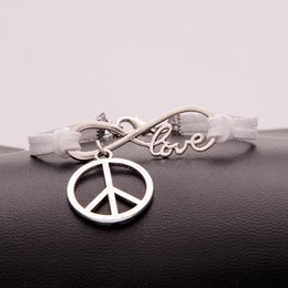 Man Woman Sign NZ - Vintage Charming Silver Infinity Love Peace Sign bracelets Weave white leather suede cuff jewelry for women men 2018 Boho Bangles Wholesale