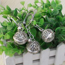 Keys Bell Australia - Simple openwork metal bell key chain pendant palace bell couple ornaments