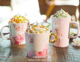 $enCountryForm.capitalKeyWord Australia - Genuine 2016 Starbucks Peach blossom Flower ring Mug Pink Gold handle coffee cup 12OZ Relief Mermaid logo Ceramic Mug