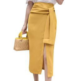 b7cab82a79 2018 Señoras de verano falda de la oficina arco dividido vendaje irregular  faldas largas para mujer OL paquete cadera breve jupe femme elegante faldas