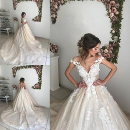Lace Wedding Dresses Australia - Arabic Champagne 2019 A Line Wedding Dresses Off Shoulder Cap Sleeves Backless Lace Appliques Court Train Sexy Custom Bridal Gowns Plus Size