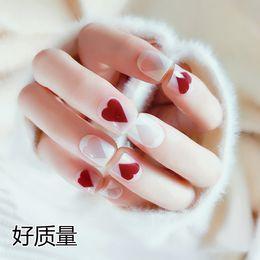 $enCountryForm.capitalKeyWord Australia - New High-quality 24pcs lot Lovely red heart shape False nail Short style Nail Tips Art Design gel Fake Nails white free shipping