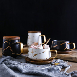 Wholesale Luxury Matte Ceramic Marble Tea Coffee Cups and With Wood Saucers Black and White Gold Inlay Ceramic Cups