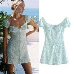 Vente en gros Été Vente Chaude De Mode Femmes Impression À Manches Courtes Manches Bouffantes Sandy Beach Mini Robe de haute qualité 2019 W418