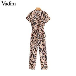 jumpsuits patterns NZ - Vadim Women Leopard Print Jumpsuits Short Sleeve Bow Tie Sashes Animal Pattern Pockets Rompers Female Chic Long Playsuits Ka793 Y19071701