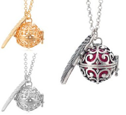 $enCountryForm.capitalKeyWord Australia - 2019 New Wing Cage Pendant Necklaces Gold Hollow Pregnancy Ball Pendants Baby Chime Diffuser Lockets Necklace With Sponge ball