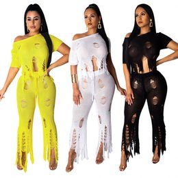 China 2019 Newest Sexy Hole Hollow Out Knitted Women Two Pieces Pant Suits One Shoulder Short Sleeve Cropped Top + Long Pants Beach Party Outfits suppliers