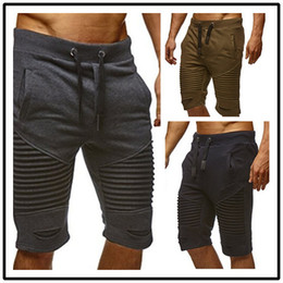 $enCountryForm.capitalKeyWord Australia - Summer Men Shorts Draped Trousers Folds Hole Elastic Fashion Shorts Rope Belt Mens Pants Knee Length Clothing M-3XL Wholesale