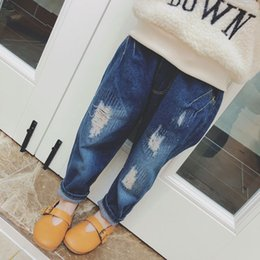 698025f27754 Spring New Loose Baby Boy Jeans Denim Pants Fashion Baby Girls Ripped Hole  Jeans Kids Big Pants Children Trousers 2-7 Years