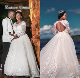 Gold applique weddinG Gown online shopping - African Lace Wedding Dresses Ball Gown Sheer Boat Neck Illusion Long Sleeves Backless Beaded Appliques Tulle Bridal Gowns