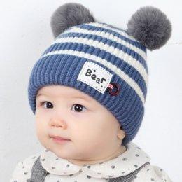 5d6a3424790 Children s hat winter warm ball knit hat boy girl double ball wool cap baby  hair hats earmuffs Baby