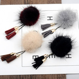 new asian winter coats Canada - Hot Sale and Brand New Cute and Beautiful Mink Fur Ball Tassel Lorean Brooch Coat weater Accesories Winter