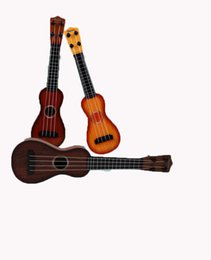 Toy String Instruments Australia - Children's beginner wood grain ukulele small guitar can play simulation musical instrument toy ukulele children practice four-string guitar