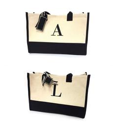 Hot food packaging online shopping - Canvas Monogram Bag Simplicity Portable Package English Alphabet Shopping Wrap Senior High Capacity Handbag Black Base Hot Sale scb1