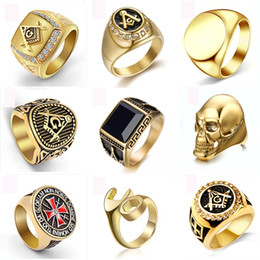 Wholesale cast band for sale – custom Gold color fashion attractive titanium steel ring personality domineering skull titanium steel ring men casting genstone champion rings