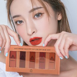 $enCountryForm.capitalKeyWord NZ - Five Pcs Pumpkin Eating Earth Color Big Red Lipstick Waterproof Mini Combination ---MS