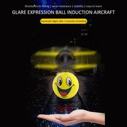 Toy airplane flies online shopping - Lovely Suspension Toy Mini Drone Hand Induction Flying Ball Facial Expression Toy Funny RC Helicopter Airplane For Kid Toys Present Gift