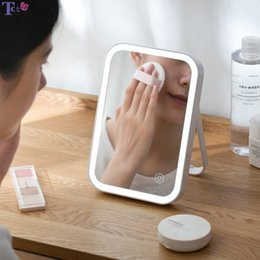 cosmetic tables NZ - LED Backlit Mirror Home Desktop Charging ABS 3.7V 1.48W Folding Makeup Mirror With Lights Table Mirrors Cosmetic Lamp Y200114