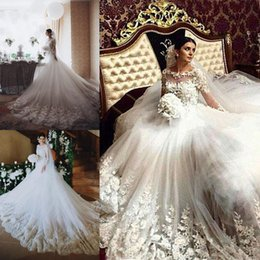 East African Wedding Dresses Australia - 2019 Illusion Neck Middle East Ball Gown Wedding Dresses With Sheer Long Sleeves Covered Button Back African Bridal Gowns Plus Size Vestidos