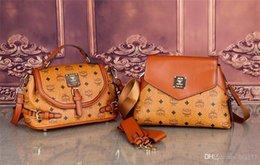 Venta al por mayor de 2019 nuevo bolso de la manera cadena de hombro de alta calidad bolso de la manera ocasional borla de la decoración caliente handbag24 solo hombro