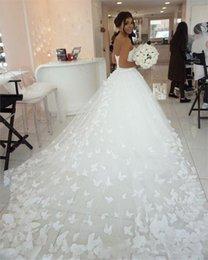 2019 Nuevos vestidos de novia de diseño Corte de tren Apliques florales Mariposa Vestidos de novia Vestidos de novia de tul por encargo