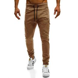 c0f2b1f3f4 2019 Hot New pantalones de hombre marca de moda delgado color sólido  elasticidad hombres pantalones casuales hombre pantalones diseñador Khaki para  hombre ...