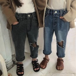 $enCountryForm.capitalKeyWord Australia - Fall INS Newest Alternative Designs INS Kids Boys Hole Jeans Trousers Fashion Back Front Buttons Pockets Autumn Children Girls Denim Pants