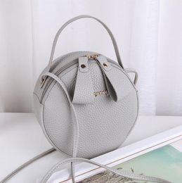 Cute Small Cosmetic Bag Australia - Cute small round bag shoulder diagonal portable cosmetic bag wholesale small wild trend Fabric texture PU