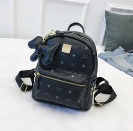 4dce49fd2 MC mochila nova marca arrivel designer de moda coreano homens mochila  escolar marca de venda quente Punk rebite mulheres ombro mochila sacos de  estudante