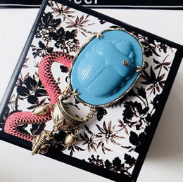 $enCountryForm.capitalKeyWord NZ - Guc 2019 new ladies turquoise egg-shaped carved brooch vintage print style unique personality brooches for women