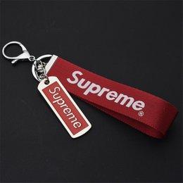 Encantos de Telefone Celular Encantos Acessórios Chaveiro Universal Marca de Moda Fita Vermelha De Couro Preto Celular Accessorie
