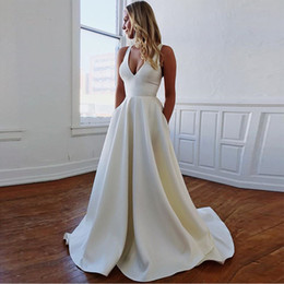 satin cut out wedding dresses Canada - Simple V-neck Wedding Dresses Cut-out Bow Back Sleeveless Covered Button White Ivory Sexy Beach Wedding Gown