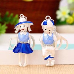 $enCountryForm.capitalKeyWord NZ - New Creative Alloy Cute Sunshine Couple Key Chain Boy Car Keychain Female Bag Pendant Accessories Girl Gift Key Ring
