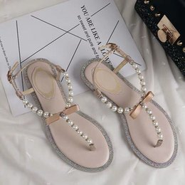 Wholesale 2019 new designer explosion models rc with the same paragraph pearl sandals female fairy wind flat wild beach holiday rhinestones toe sandal