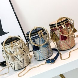 wind straw NZ - fashion chain national wind ring hand strap shoulder diagonal woven straw cylinder small bag tassel bucket bag 17.5*11.5*11.5 female bag
