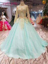 $enCountryForm.capitalKeyWord Australia - AXJFU Luxury princess blue lace wedding dress high neck beading golden flower blue lace wedding dress 100% real photo 550