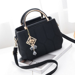 $enCountryForm.capitalKeyWord Australia - Fashion New Korean version lady bag fashionable elegant embroidery line pearl pendant bag single shoulder well selling Totes