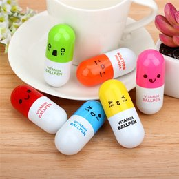 kids wholesale stationery NZ - Cute Pill Shape Retractable Ballpoint Pen Kawaii pill shape novelty ballpen Lovely learning stationery Kids toy gifts