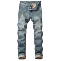 dfcdfc0e43b 2019 новый мужской отверстие прямой тонкий джинсы кнопка ностальгические  Мужская одежда рваные не эластичный большой размер джинсовые брюки больше  размер ...