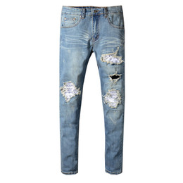 Chinese  2019 fashion hole straight jeans men's slim printed jeans men's tide brand hole denim fabric hip hop boot casual pants 550 manufacturers