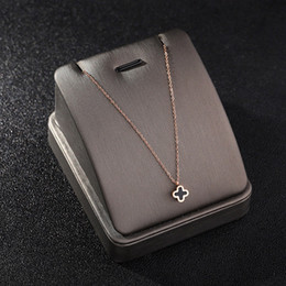 chain hollow snake silver NZ - Four-leaf clover necklace ECG hollow skeleton clavicle chain letter H pendant black round cake pendant necklace fashion jewelry