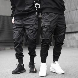 Hombres Cintas Bloque de color Pantalones cargo de bolsillo negros 2019 Harem Joggers Harajuku Sweatpant pantalones de hip hop en venta
