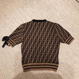 24030bd5a81d 2018 Estilo de moda Diseño de lujo Letra de calidad superior FF Mujer Mujer  Señora Cuello redondo Mangas cortas Tejidos de lana Suéter 1 pieza Envío  gratis