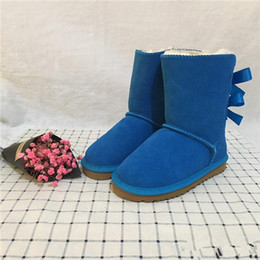 Wholesale designer Boots Boys and Girls Australia Style Kids Snow Boots Cute Bow Back Waterproof Button Children Winter Cow Leather Boots