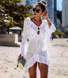 $enCountryForm.capitalKeyWord NZ - New Europe Women's Prevent Bask Tops Bikini Smock V Neck Knitted Beach Coat Lady Outwear Crochet Dress C4128