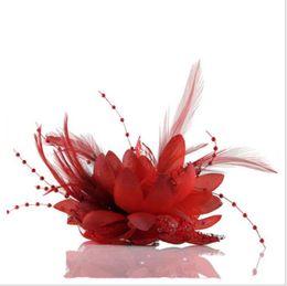 China Bride jewelry red wedding headdress, breast flower feather headdress Wedding Shop wrist flower bride headdress supplier red feather headdress suppliers